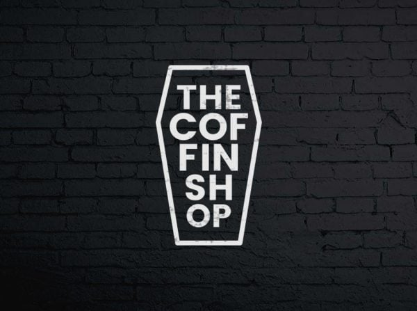 creative-logo-design-the-coffin-shop-on-brick-wall